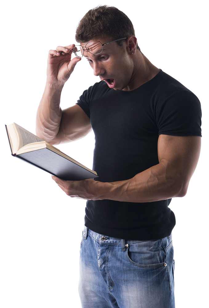 33154047 - surprised or shocked handsome sexy muscular man reading book isolated on white background, wearing glasses