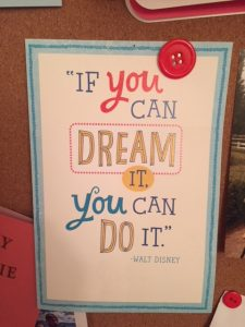 Card pinned on bulletin board that reads 'If you can dream it, you can do it' by Walt Disney