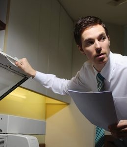 Man secretly copying documents