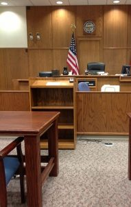 Empty courtroom with U.S. flag